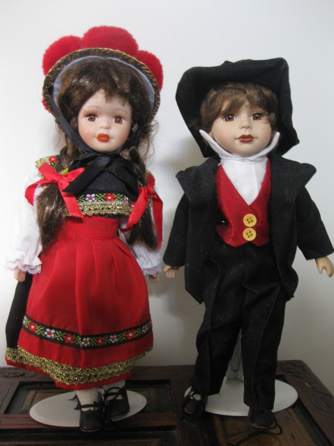 My Nanna Rosie had a huge doll collection and left them to her granddaughters in her will. These are the two I chose. They're small and strange but almost look like brother and sister, or sister and sister if you note the lipstick on the doll in the suit.