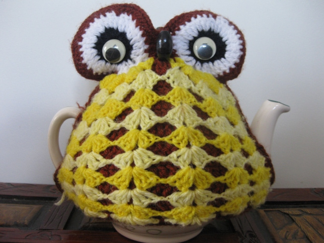 My Nanna knitted this owl tea cosy. That's her very well used teapot too. It's more than a little stained inside. She had a big family to make tea for.