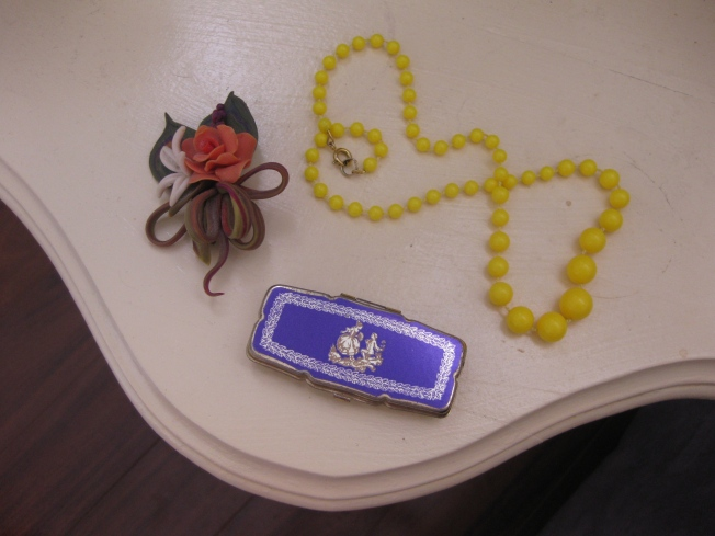 My Nanna's brooch and little pillbox and my Mum's beads that go perfectly with my favourite yellow dress.